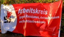 Banner des Arbeitskreis gegen Rassismus